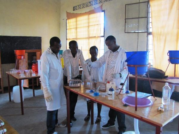 Teachers doing Chemistry Experiments in Training at GS Kavumu Musulman