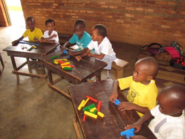 Des Amis nursery pupils using our teaching aids